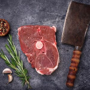Lamb meat with rosemary, spices and cleaver.
