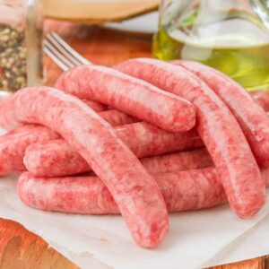 raw white sausages on rustic wooden